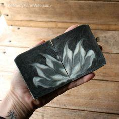 Activated charcoal colors this all-natural palm-free soap